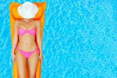 Female beauty relaxing in swimming pool Stock Images