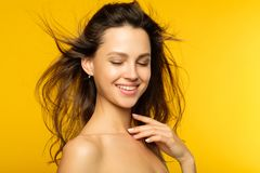 Female beauty wellnes health girl hair smooth skin. Female beauty wellness and health concept. girl with radiant smooth skin and long shiny hair. portrait of stock photography