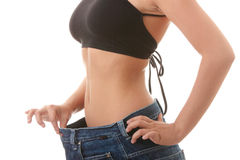 Female became skinny and wearing old jeans Stock Photos