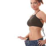 Female became skinny and wearing old jeans Royalty Free Stock Photography