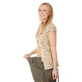 Female became skinny and wearing old pants Royalty Free Stock Photography