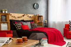Female bedroom design. Brave inspiring female bedroom design with red color Stock Image