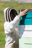 Female Beekeeper Working At Apiary Royalty Free Stock Photos