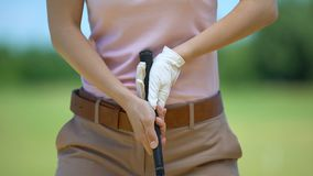 Female beginner golf player training in basic ball position, elite hobby, lesson. Stock footage stock footage