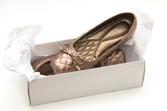 Female beige shoes on shoe box. Isolate Royalty Free Stock Photo