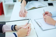 Female being ready to take notes at seminar. Concept of successful team work Royalty Free Stock Image