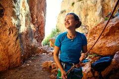 Female belayer with the rope Royalty Free Stock Images