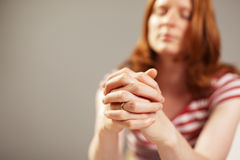 A female believer praying with faith Royalty Free Stock Image