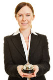 Female bellhop with hotel bell Stock Image