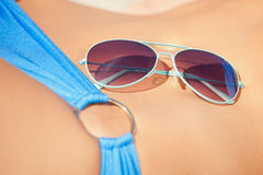 Female belly, bikini and shades Royalty Free Stock Photos