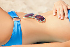 Female belly, bikini and shades Stock Photo