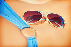Female belly, bikini and shades Royalty Free Stock Image