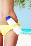 Female belly with body lotion Royalty Free Stock Photo