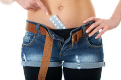Female belly with contraception pills, isolated Stock Photo