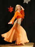 Female belly dancer. On stage with colourful oriental costume Royalty Free Stock Image