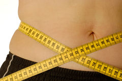 Female belly with tape measure Stock Photo