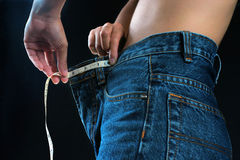 Female belly with tape measure Stock Image