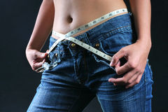 Female belly with tape measure Stock Photos