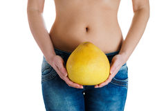 Female belly. Woman Hands holding pomelo. IVF, pregnancy, diet concept. Female stomach and hands holding pomelo. IVF, pregnancy, diet concept Royalty Free Stock Photos