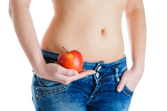 Female belly. Woman Hands holding red apple. IVF, pregnancy, diet concept. Female stomach and hands holding red apple. IVF, pregnancy, diet concept Royalty Free Stock Photo