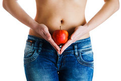 Female belly. Woman Hands holding red apple. IVF, pregnancy, diet concept. Female stomach and hands holding red apple. IVF, pregnancy, diet concept Stock Photos