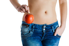 Female belly. Woman Hands holding red apple. IVF, pregnancy, diet concept. Stock Image