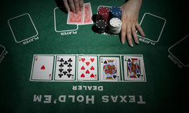 Female bet in a poker game Royalty Free Stock Photos