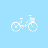 Female bicycle with a basket Royalty Free Stock Photos