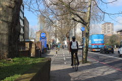 Female bicycle commuter in London, England, green energy, urban scene, transport Stock Image
