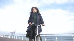 Female with bicycle stock video