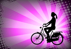 Female bicyclist on the abstract purple background Stock Photos