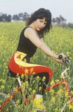 Female bicyclist resting in field of Spring flowers, Malibu, CA Royalty Free Stock Photo