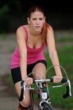 Female bike rider - bright clothing Royalty Free Stock Image