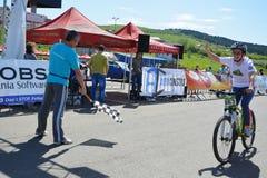 Female bike rider at finish line Stock Image