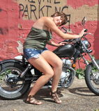 Female biker. Royalty Free Stock Images