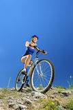 Female biker biking a mountain bike. Outdoor Stock Photo