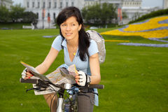 Female biker with the city map Royalty Free Stock Photo