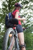 Female biker  on her mountain bike Royalty Free Stock Image