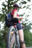 Female biker  on her mountain bike Stock Photo