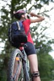Female biker  on her mountain bike Stock Images
