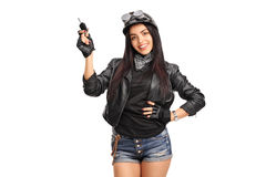 Female biker holding a car key Stock Photos