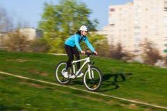 Female biker in motion Stock Photos