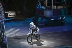 Female biker performs at Barclays in Brooklyn during Ringling Br. BROOKLYN, NEW YORK - FEBRUARY 25: Female biker performs during Ringling Bros Barnum Baley Stock Photo