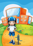 A female biker standing in front of a school building Royalty Free Stock Photos