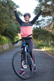 Female biker standing with mountain bike in country side Royalty Free Stock Photo