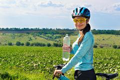 Female biker with water bottle Stock Photography