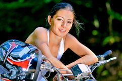 Female biker. A young woman on the bike royalty free stock photo