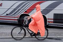 FEMALE BIKING IN RAIN Royalty Free Stock Image