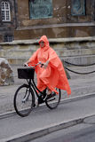FEMALE BIKING IN RAIN Royalty Free Stock Photography