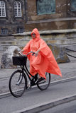 FEMALE BIKING IN RAIN Royalty Free Stock Photos